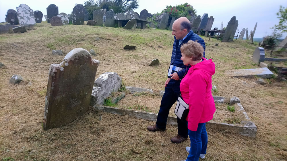 Looking at a headstone